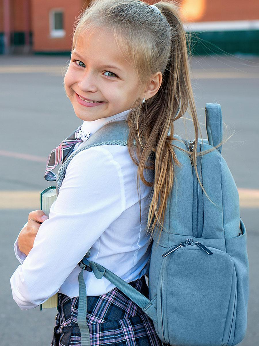 Happy, smiling schoolgirl.